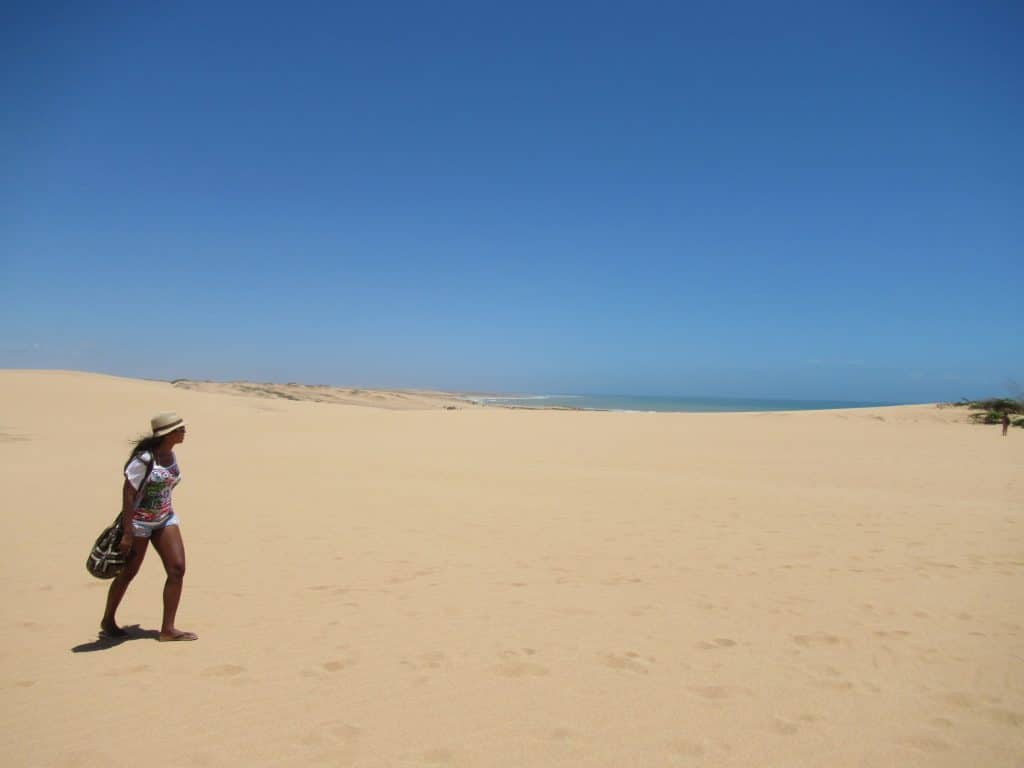 Susana walking over the Taroa Dunes, one of the things to do around Punta Gallinas.