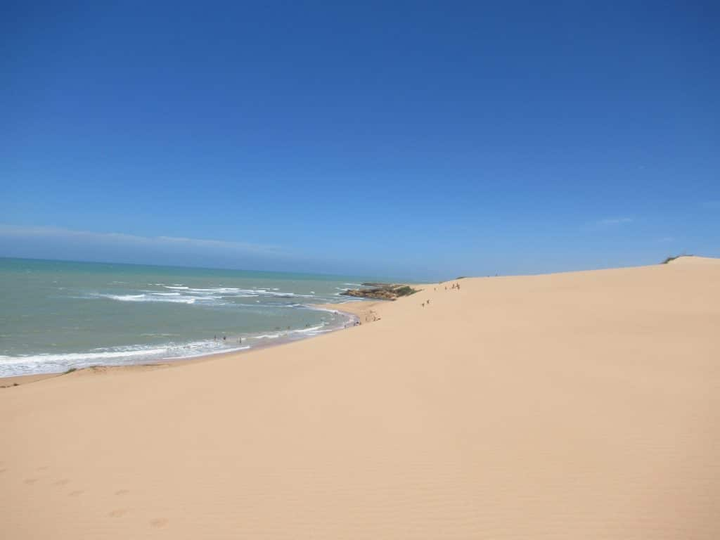 The Taroa Dunes rolling into the beach to the left, the final stop on the tour of what to see Punta Gallinas.