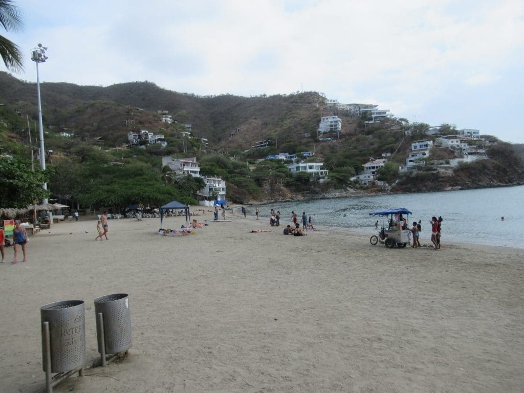 People milling on the beach during a visit to Taganga.