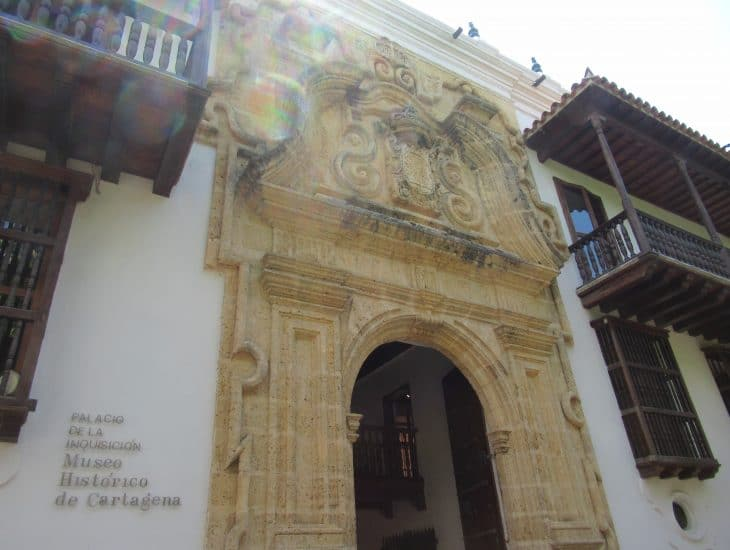The arched entryway into the colonial building housing the Cartagena Inquisition Museum
