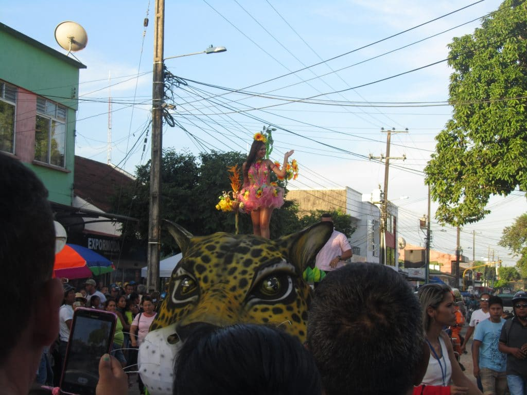 A beauty queen on top of a float that looks like a Jaguar during a parade that was part of the annual festival, one of the neat things to do in Leticia.