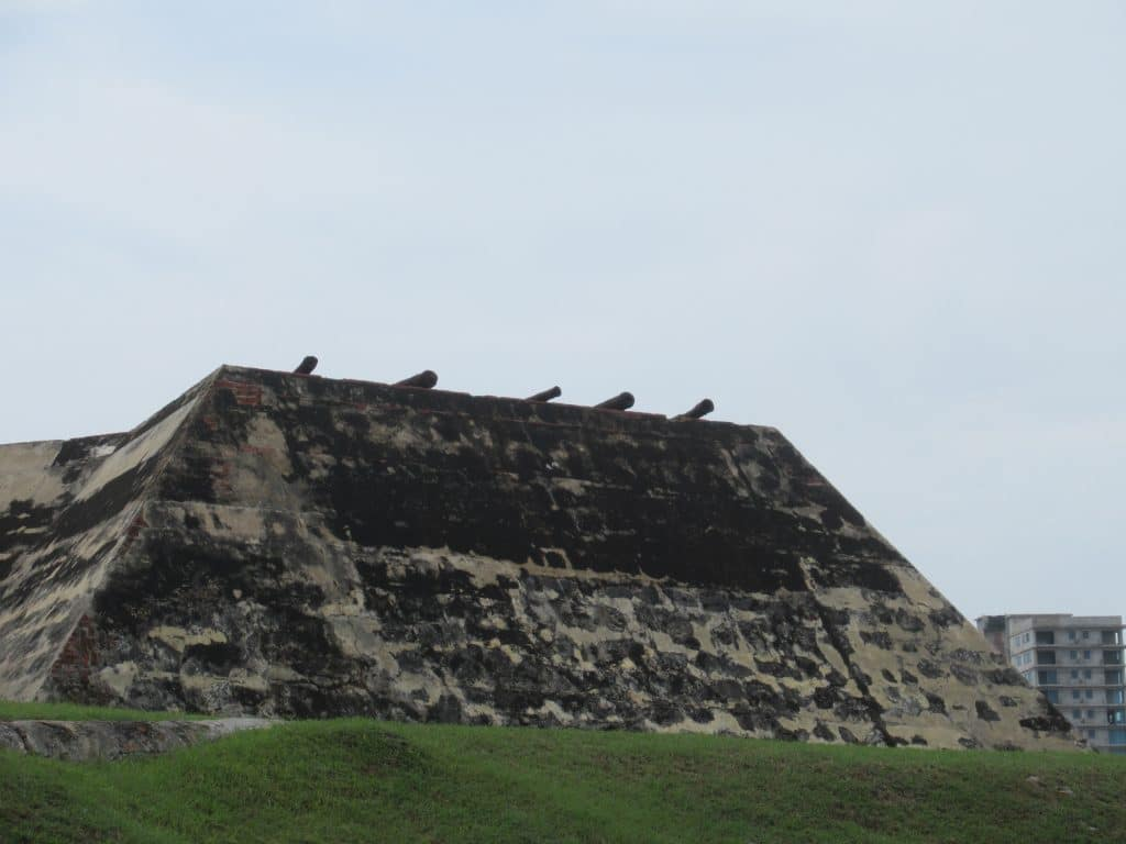 A row of cannons atop a wall of the Castillo San Felipe Fortress in Cartagena.
