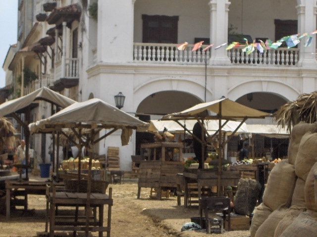 A photo from the set of Love in the Time of Cholera showing several market carts set up in front of the governor's office.