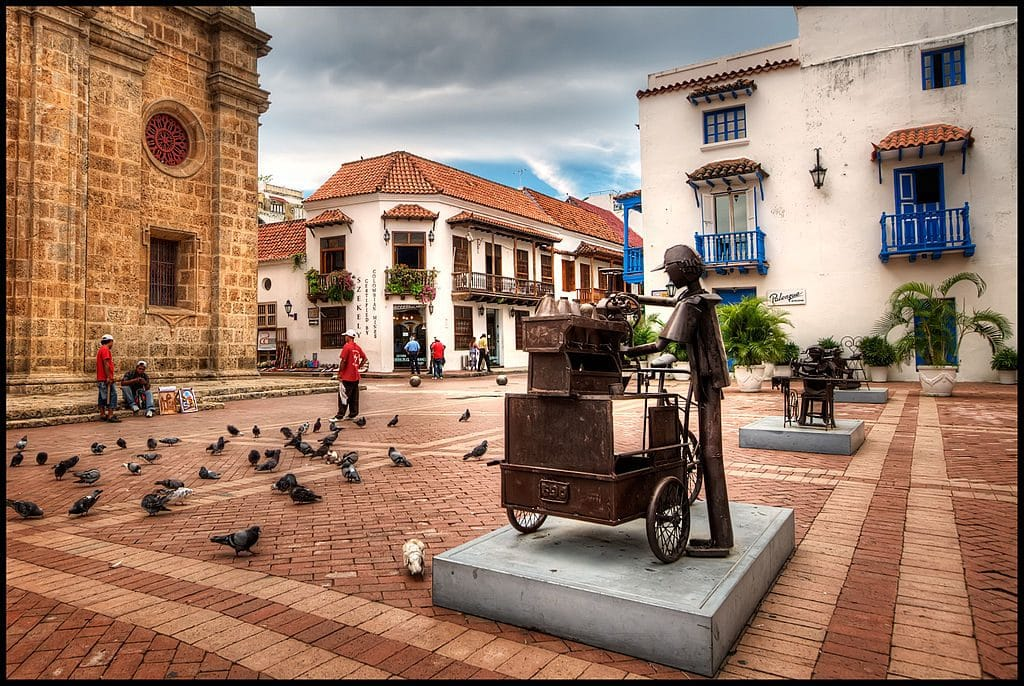 The plaza in front of the San Pedro Claver Church with some pigeons milling about, next on our list of things to do with children in Cartagena, Colombia.