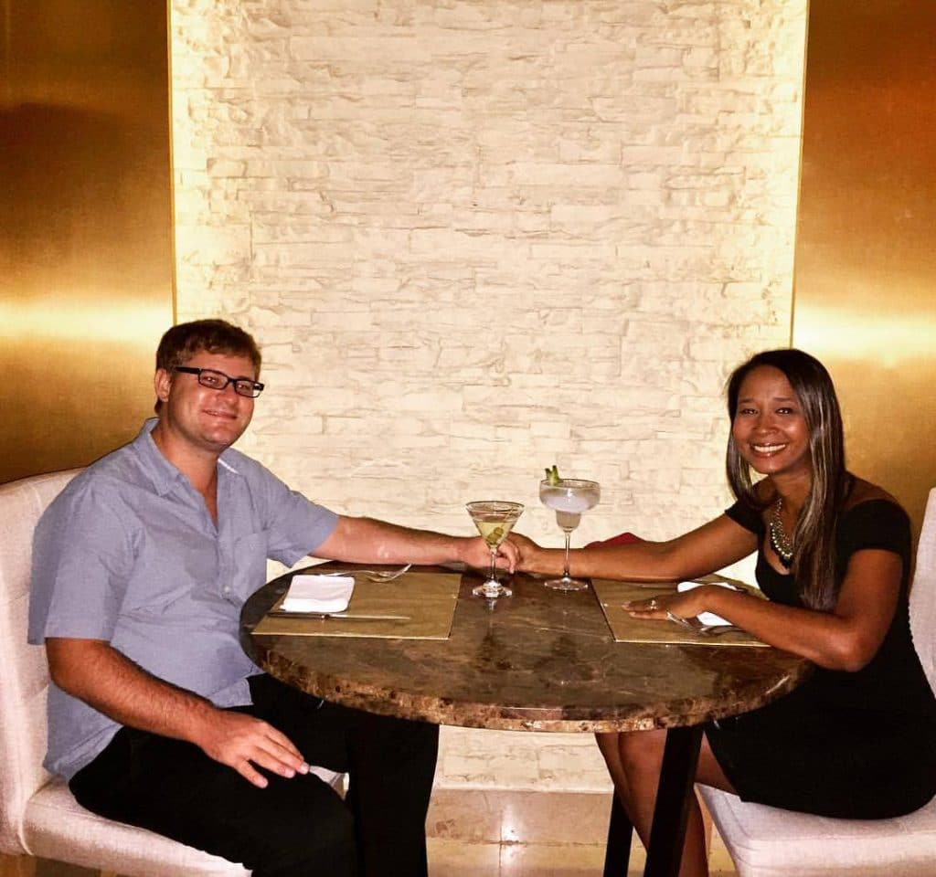 A couple sitting at a table at a romantic restaurant in Cartagena.