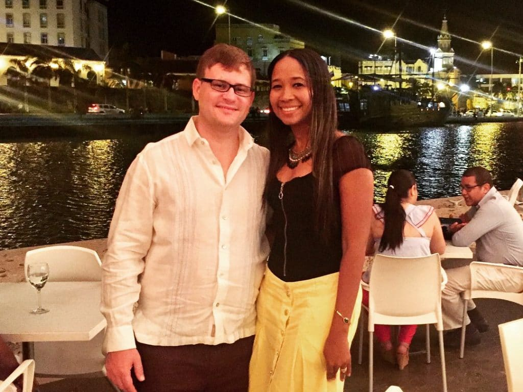 A couple standing on the deck at Marea, next on our list of where to have a romantic dinner in Cartagena.