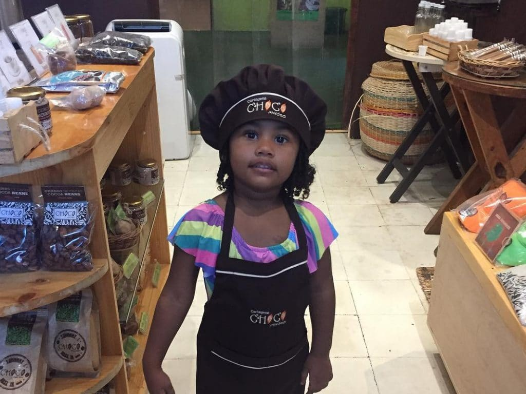 A child in the store at the ChocoMuseo in Cartagena.