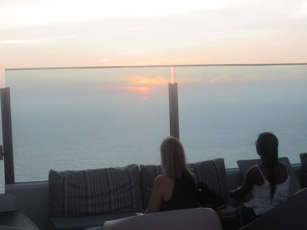 Photo of two people sitting and watching the sunset Cartagena at 51 Sky Bar