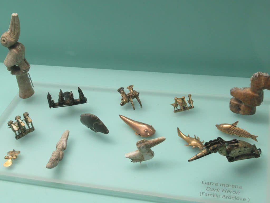 Gold animal figurines on display at the Gold Museum, another one of the child friendly activities in Cartagena.