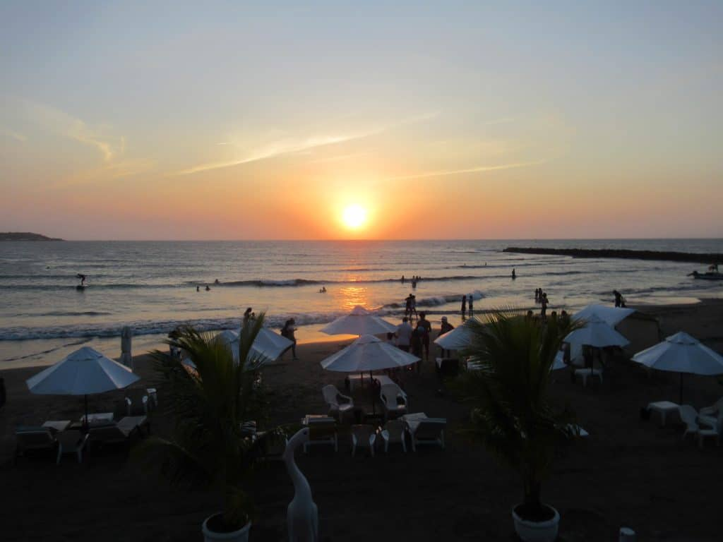 Photo of the sunset over the beach from El Muella, another one of the best places to see the sunset in Cartagena.