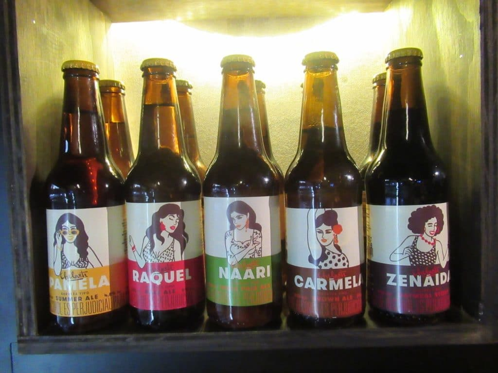 Photo of the bottles of 5 Chelarte Colombian craft beer styles, showing the label of each with the woman's picture.