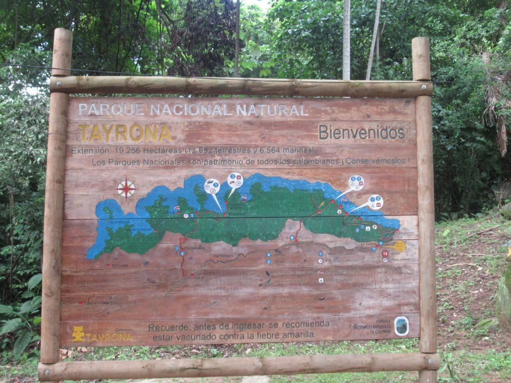 A photo of the sign near the entrance of Tayrona showing the different beaches you can visit in Tayrona Park.