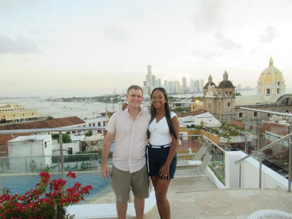 A couple on a rooftop bar overlooking the Centro of Cartagena.