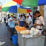 Photo of street carts selling the street food to try in Cartagena.