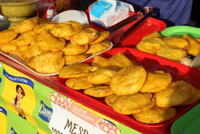 Trays holding arepas de huevo, the star of the Cartagena Fried Food Festival.