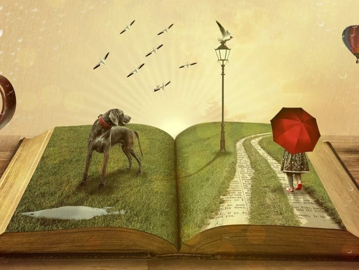 Cartoon of an open book with a dog, street lamp, and child popping up form the pages.