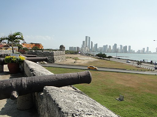 Photo showing a cannon sitting atop Cartagena's walls.