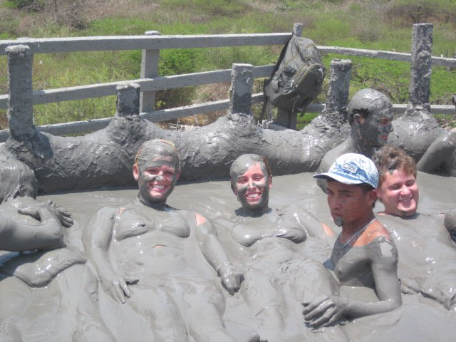 Photo of people in the mud volcano, another thing to do in cartagena