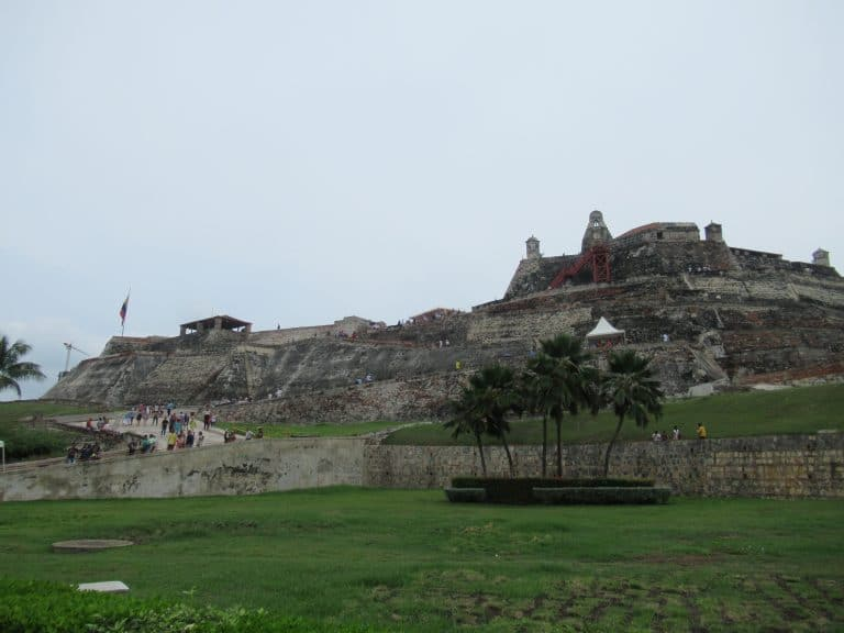 Photo of the Castillo San Felipe Fortress showing the imposing walls on this structure second on the list of things to do in Cartagena.