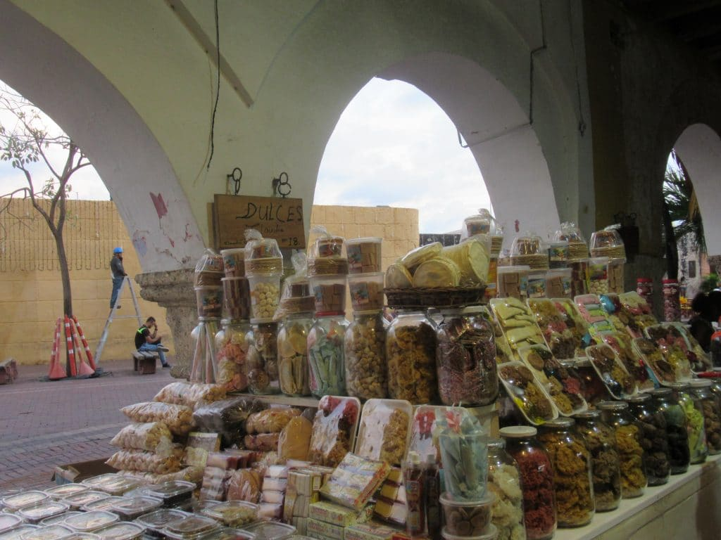 Photo of a stall at Portal de los Dulces with packages holding some of the traditional sweets.