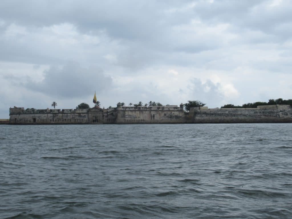 Photo of the Castillo San Fernando in Bocachica Cartagena from the sea showing the front of the fort.