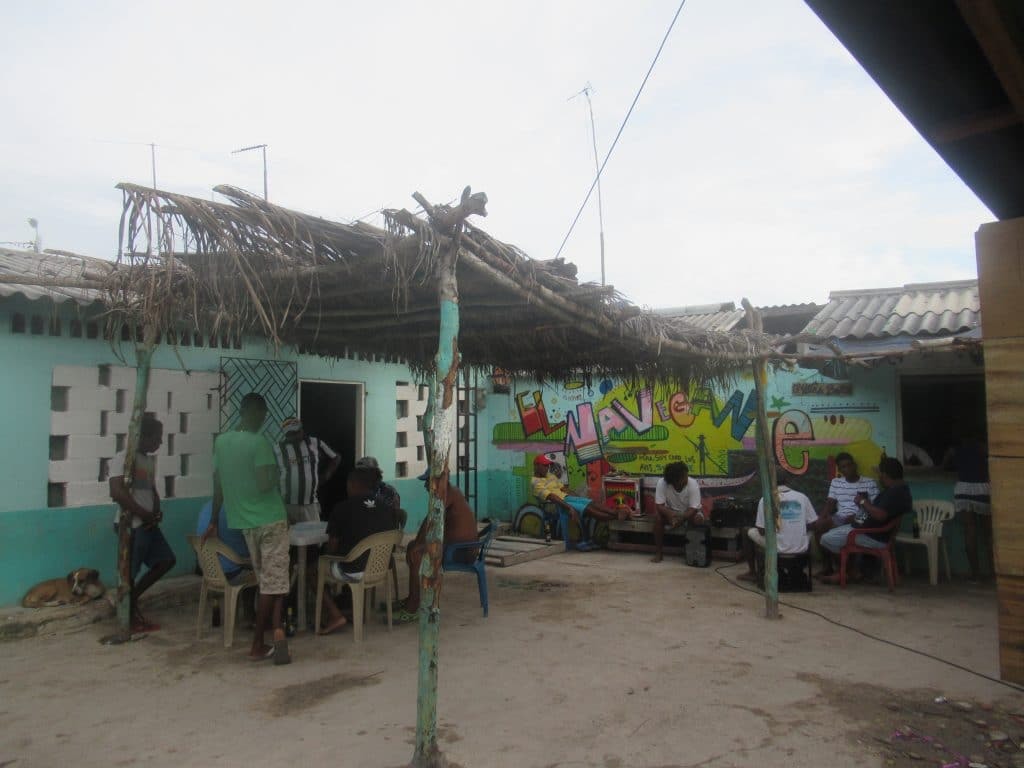 Photo of two groups of people sitting at tables in Santa Cruz del Islote