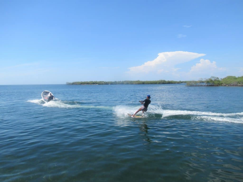 Photo a guy wake boarding at Isla Roots Hostel