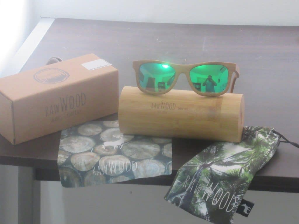 Photo showing the box, hard case, soft case, and cleaning cloth that comes with the Rawwood bamboo sunglasses