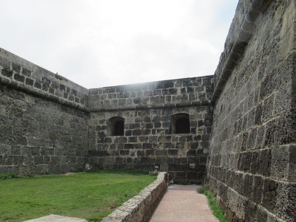 Photo of the cannon openings half way up the original Cartagena city wall.