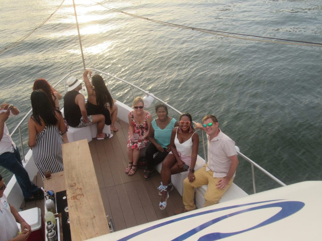 Photo of some people sitting on the front of the Sibarita Sunset Cruise in Cartagena