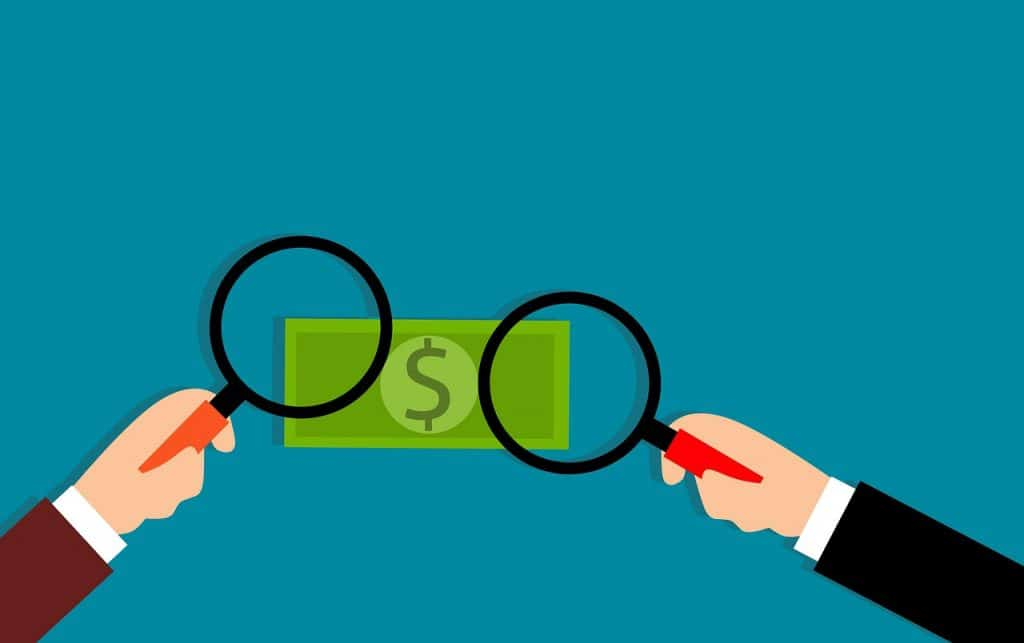 Clip art showing magnifying glasses over a dollar bill.