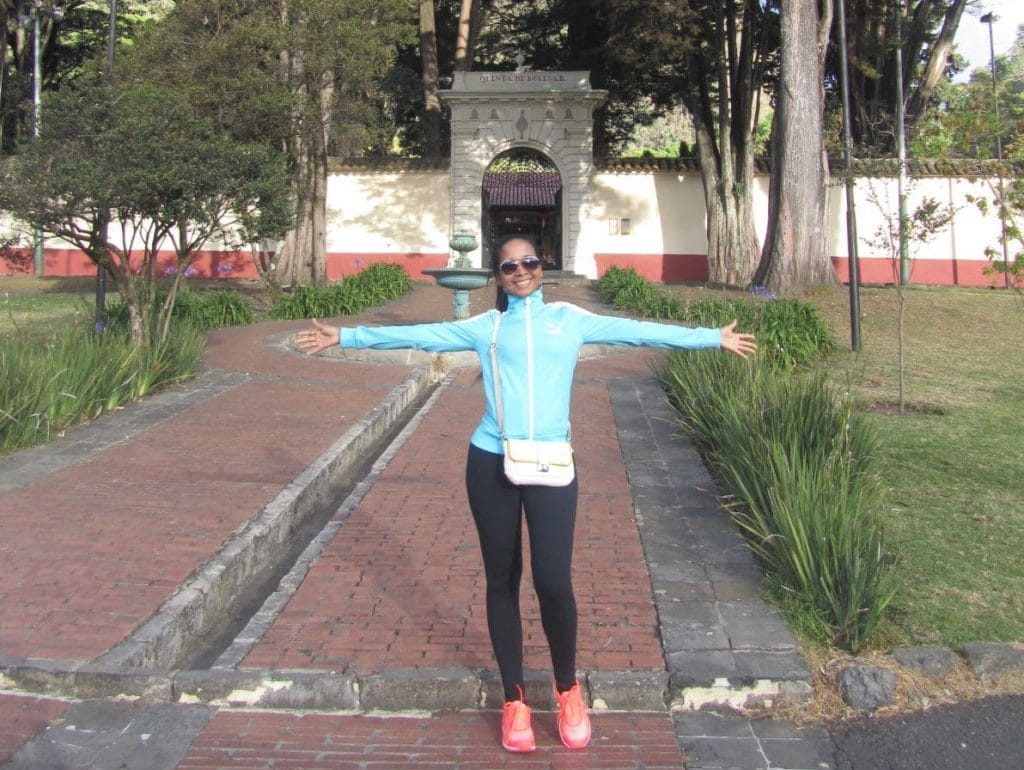 A girl standing in front of the entrance to the Quinta de Bolívar in Bogotá