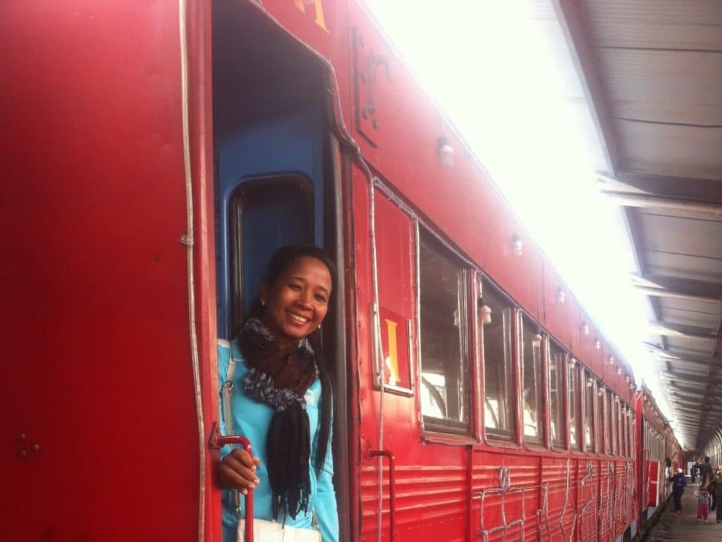 Photo of a girl standing in the doorway of a train