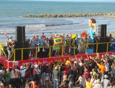 Photo of a truck with people dancing and a Cartagena flag during the Cartagena Independence Festivities.