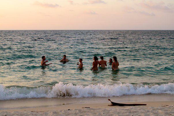 Photo of some people swimming at Playa Blanca, Cartagena.