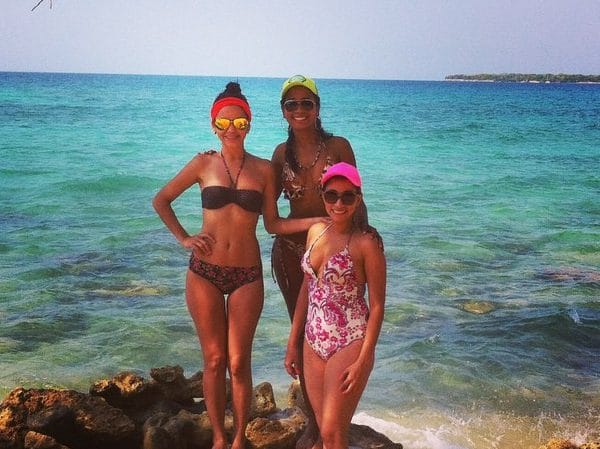 Photo of 3 girls at Playa Blanca, Colombia.