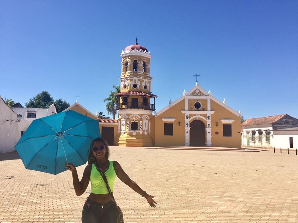 Photo of a girl standing in front of a church