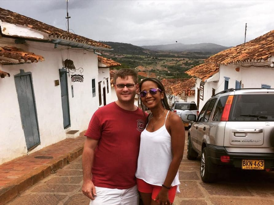 Photo of a couple standing in the street in Colombia Barichara