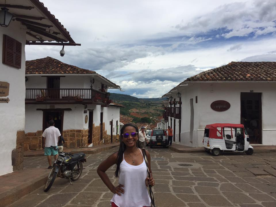 Photo of a girl standing on the street in Barichara, Colombia