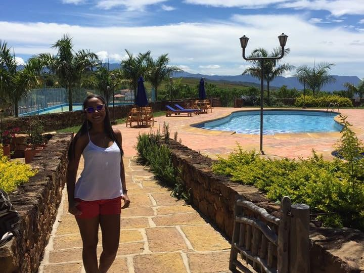photo of a girl standing infront of the pool at hotel buenos aires in Barichara, Colombia