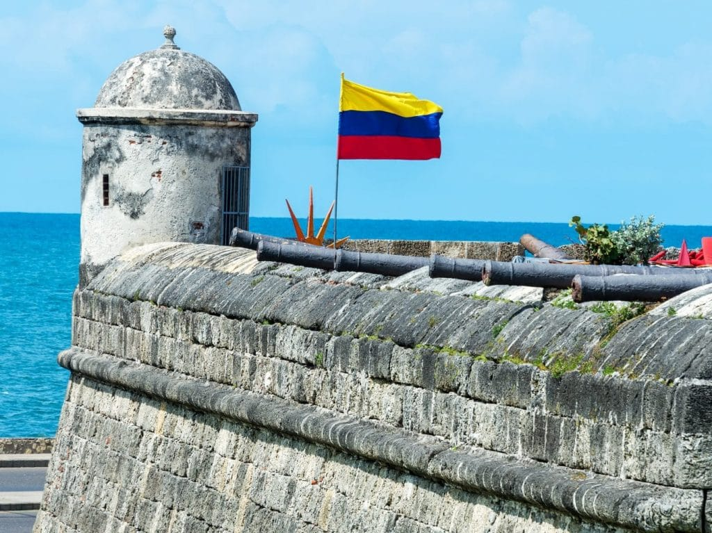 Photo of a corner of a the wall with the flag flying in Cartagena, Colombia