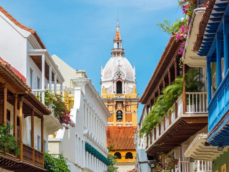 Photo of a street with the Cathedral of Cartagena, Colombia in the background.