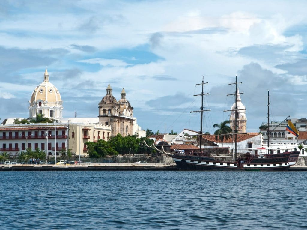 Photo of a boat and a church in the background in Cartagena, Colombia