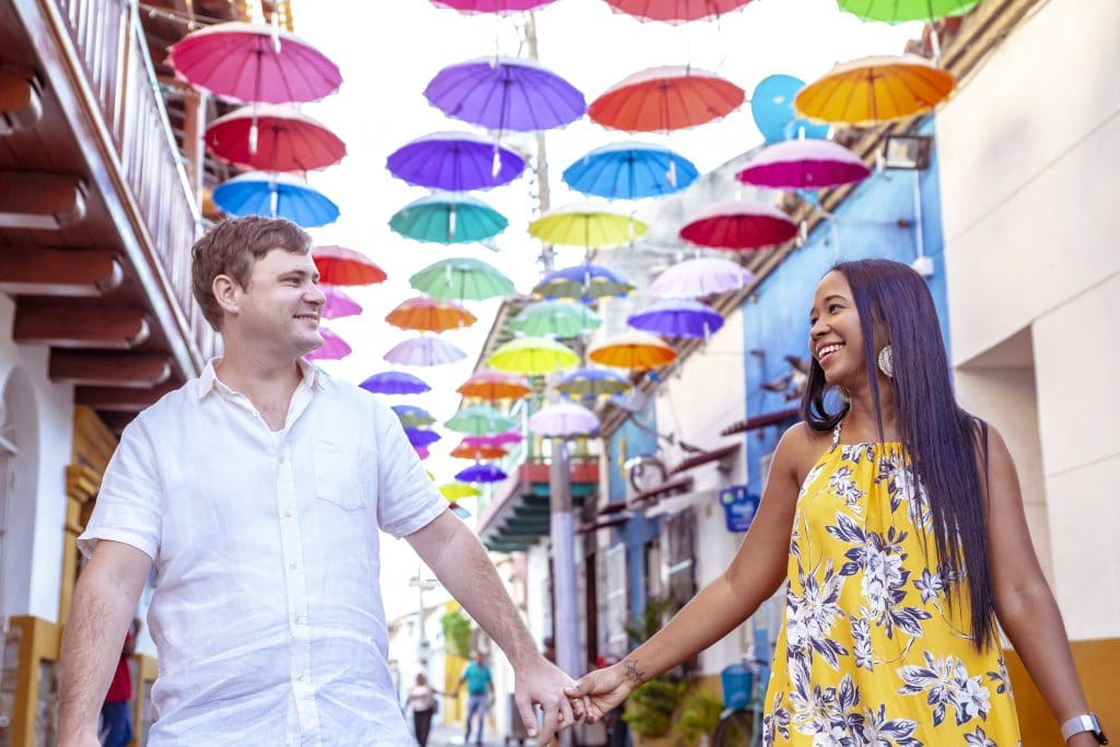 Photo of Susana and I with umbrellas overhanging the street above us.