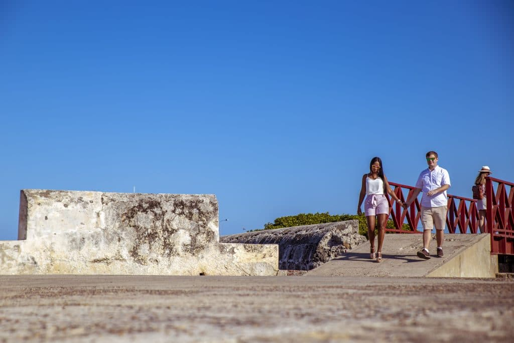 Photo of us walking atop the wall during our professional photography session in Cartagena