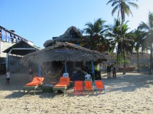 Photo of Hostel Mamallena, one of hte best places to stay in Rincón with beach chairs in front of it.