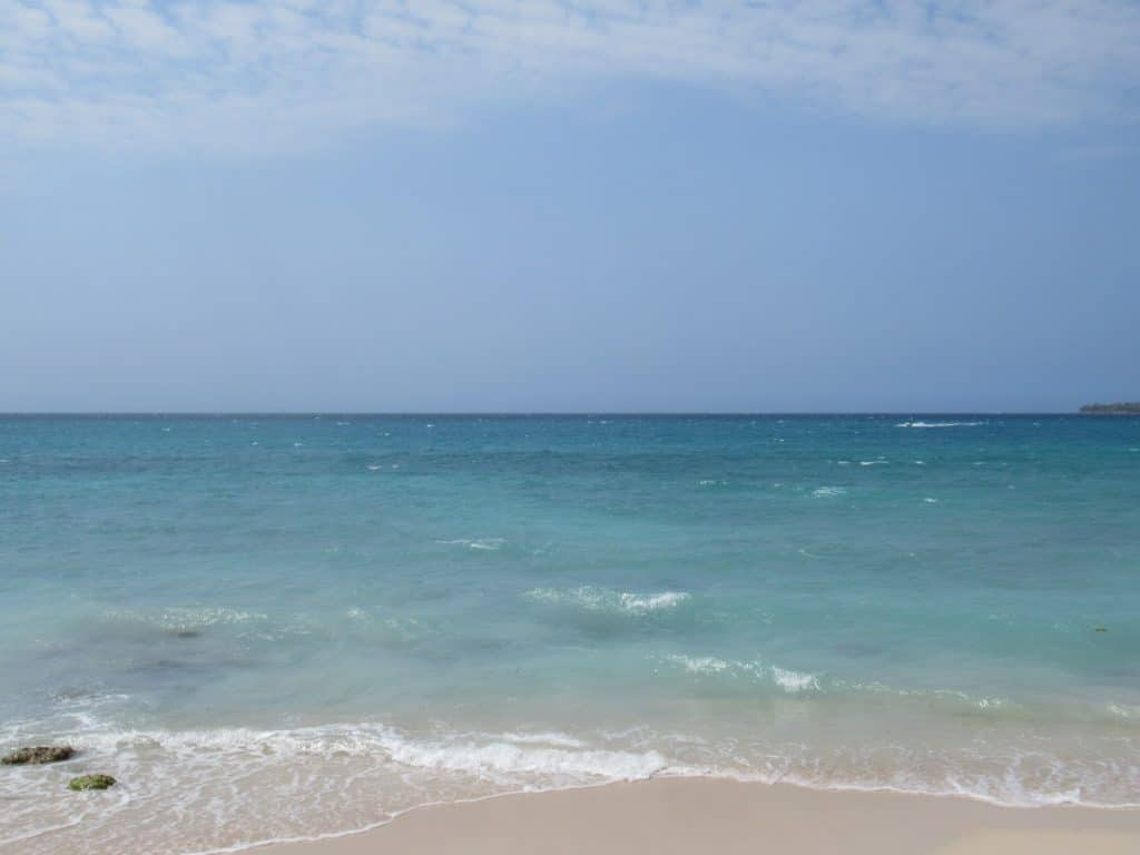 Photo of the crystal clear water you'll see when taking the shuttle bus to Playa Blanca from Cartagena.