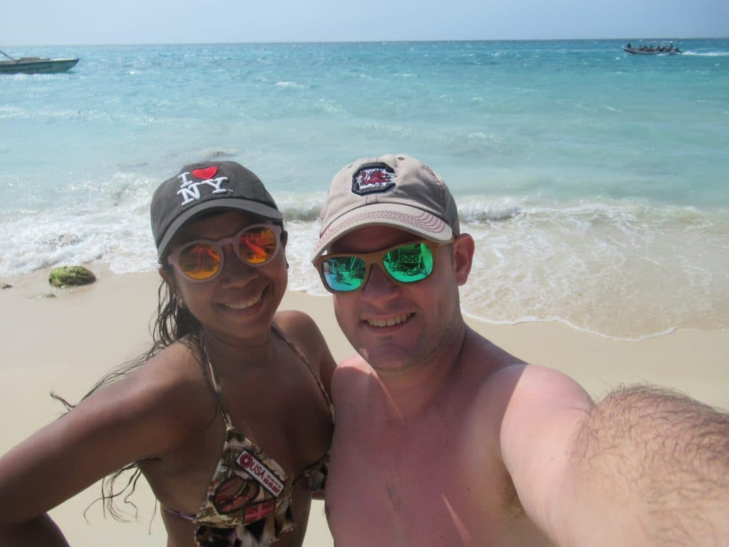 Photo of a couple at the beach after taking the Playa Blanca Shuttle from Cartagena.