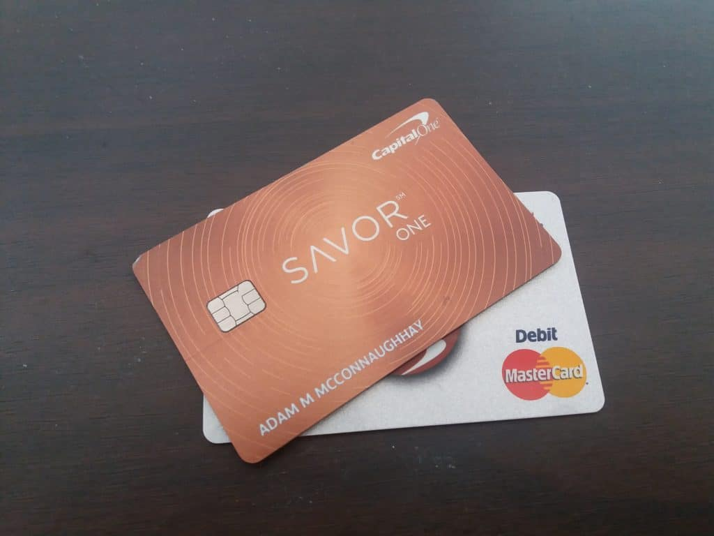 A photo of my SavorOne Credit card on top of my debit card.