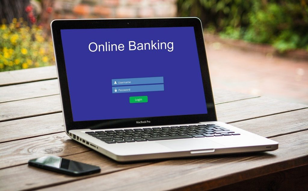 Photo of a computer with online banking on the screen